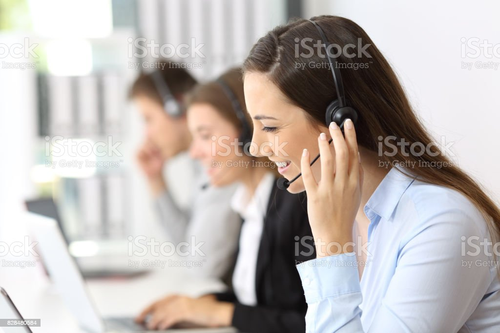 Teleoperator working at call center stock photo