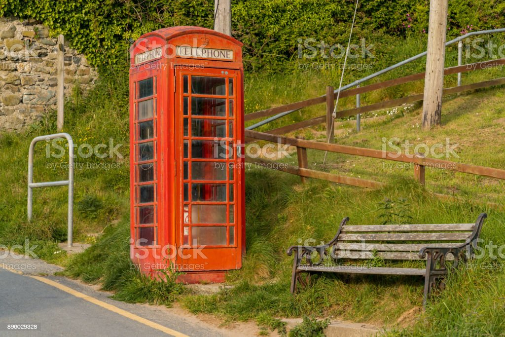Telephone booth & bench in Tresaith, Wales, UK stock photo