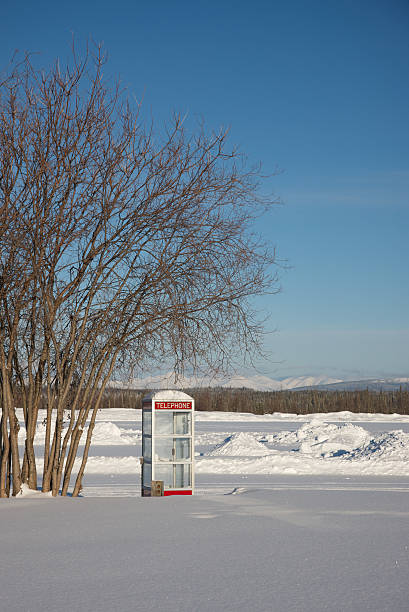 Telephone Booth in a Frozen Landscape stock photo