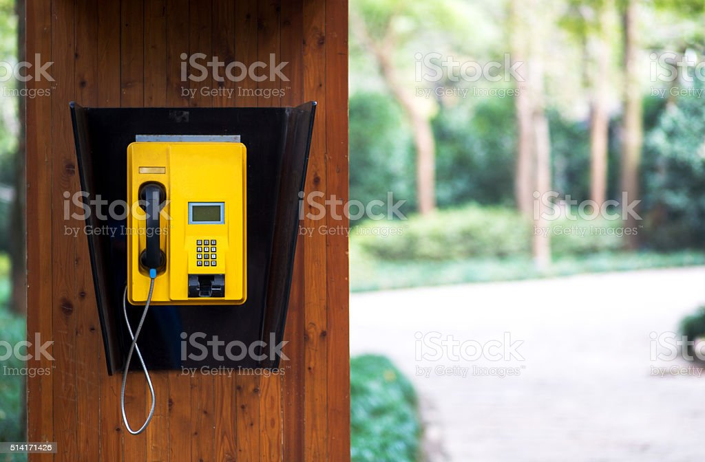 telephone booth in park stock photo