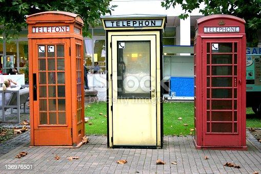 Three European telephone booths
