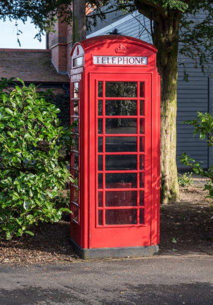 BT Telephone box among bushes in England stock photo
