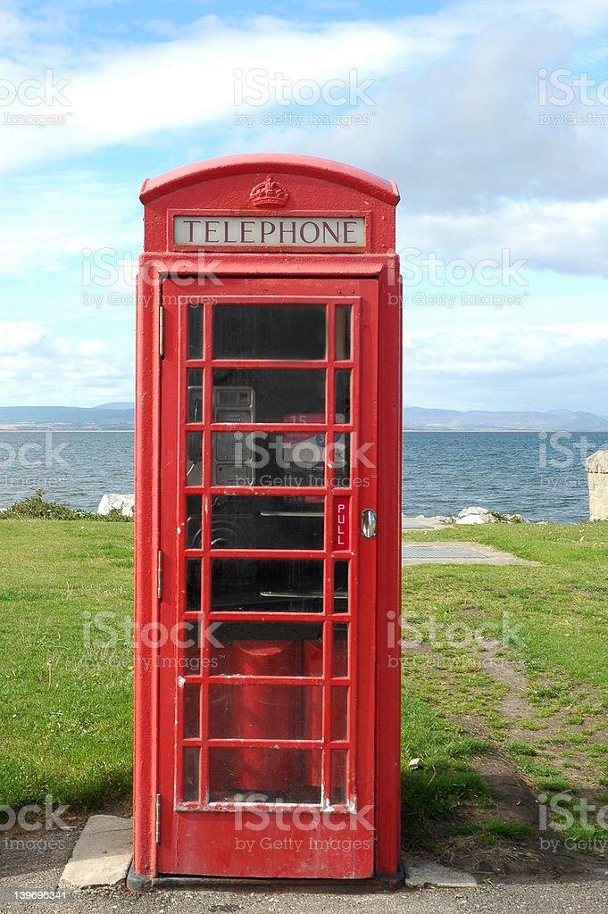 Telephone box by sea royalty-free stock photo