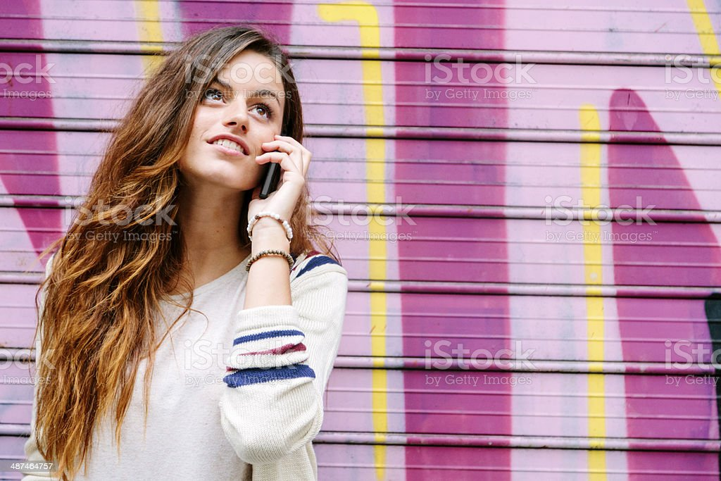 Telephone call and graffitti, Barcelona royalty-free stock photo
