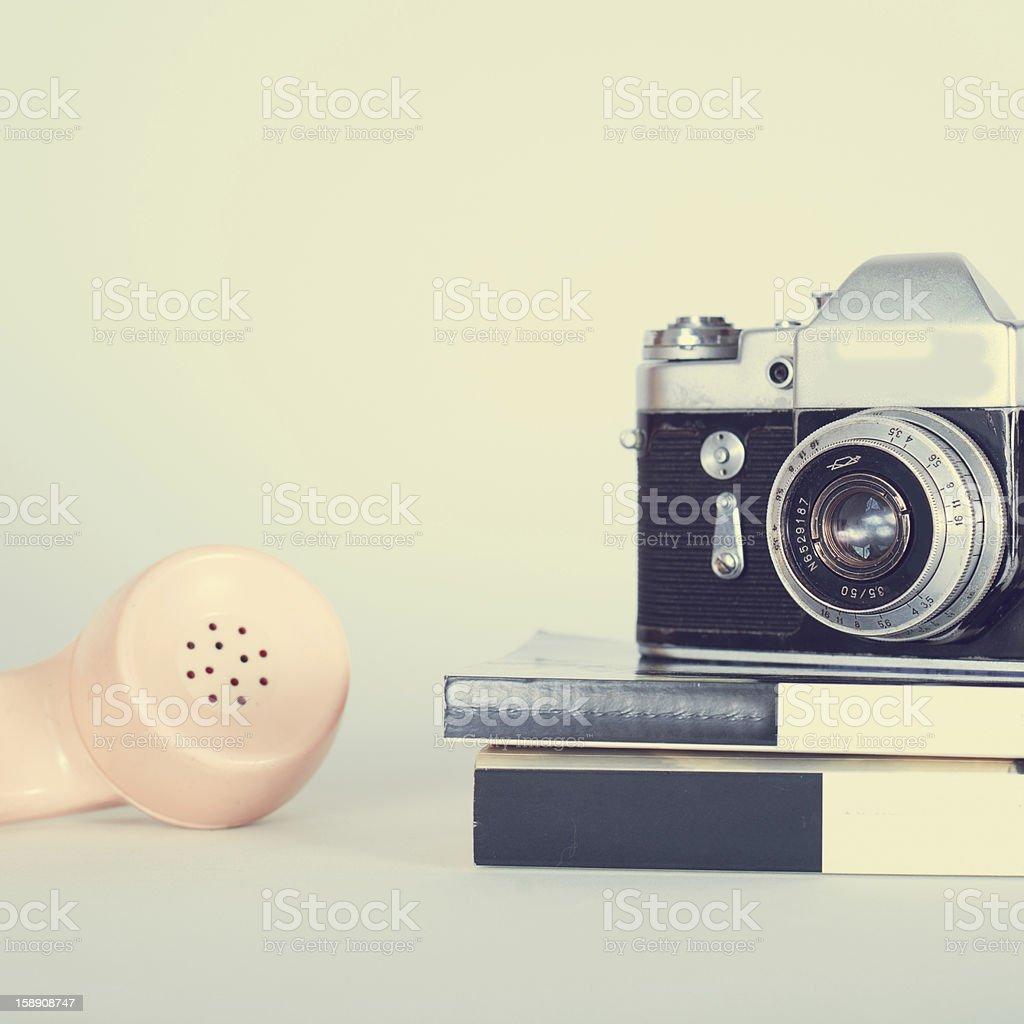 Telephone, Camera and books stock photo