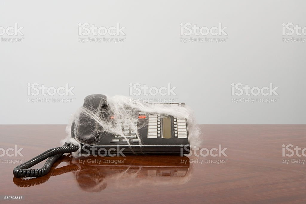 Telephone covered in cobweb stock photo
