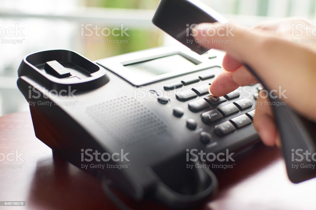 Telephone dialing ,contact and customer service concept . Selected focus . stock photo