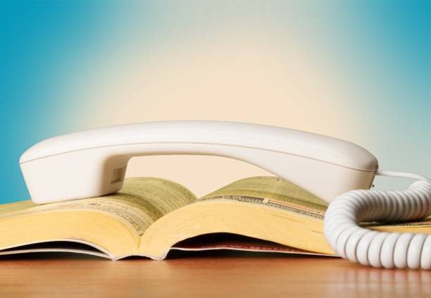 Telephone directory. Phone Book and phone handle, close-up view telephone directory stock pictures, royalty-free photos & images