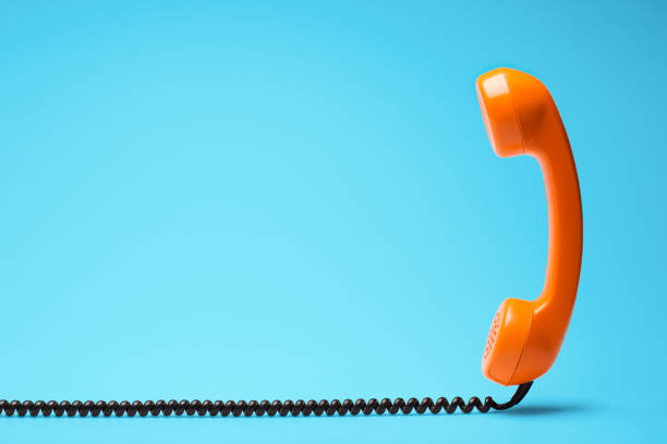 Telephone in retro style on blue background. stock photo