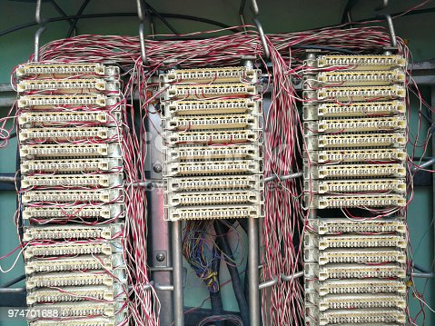 istock Telephone line connection switchboard in the cabinet at city street. 974701688