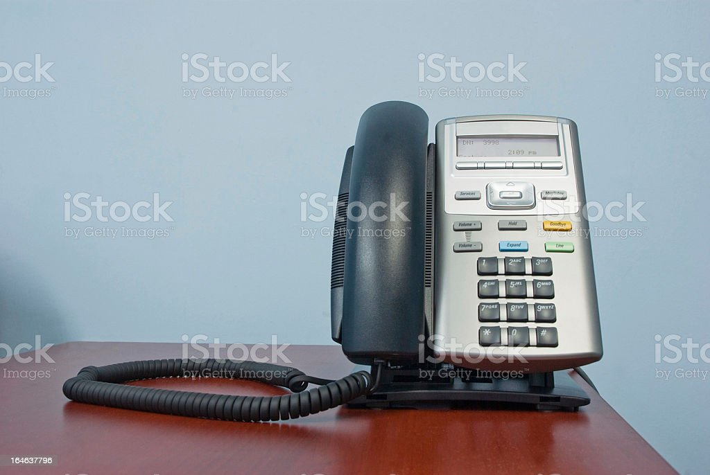 telephone on desk in office stock photo