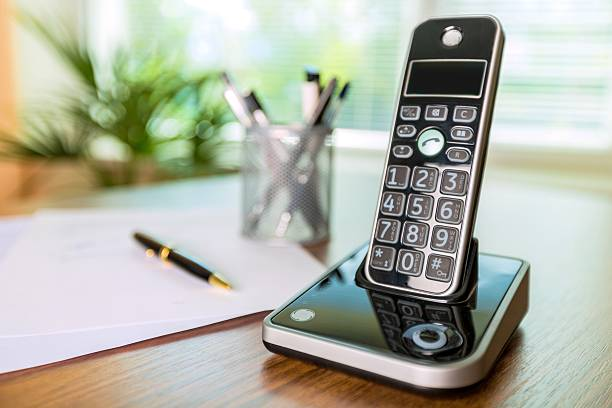 Telephone Wireless Telephone on a Wooden Desk cordless phone stock pictures, royalty-free photos & images