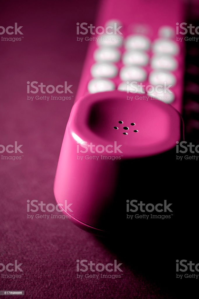 Telephone receiver close-up (pink) stock photo