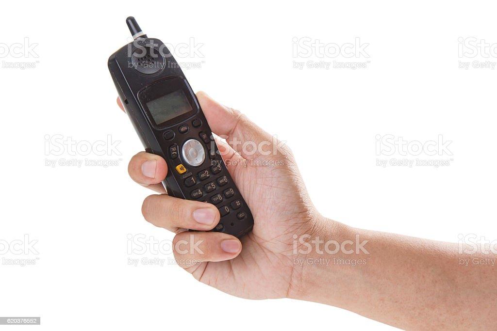 Telephone receiver in hand isolated on white background zbiór zdjęć royalty-free