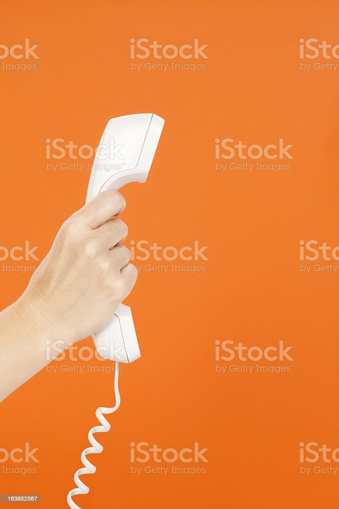 Telephone Receiver in Woman's Hand stock photo