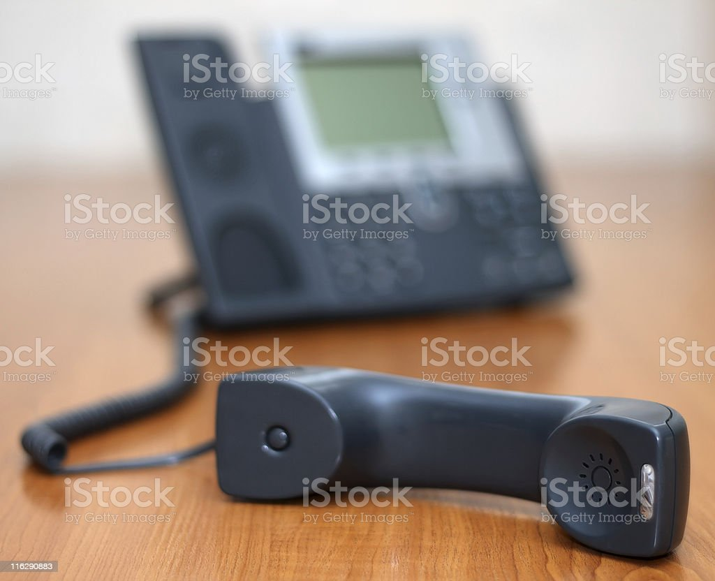 Telephone receiver with phone on background stock photo