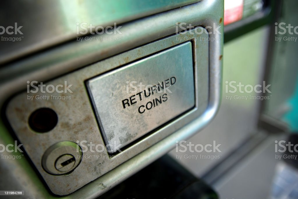 Telephone returned coins slot royalty-free stock photo