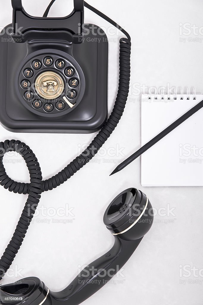 telephone with pencil and notebook royalty-free stock photo