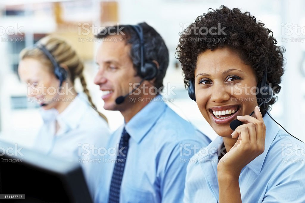 Telephonists using headsets in a call centre royalty-free stock photo