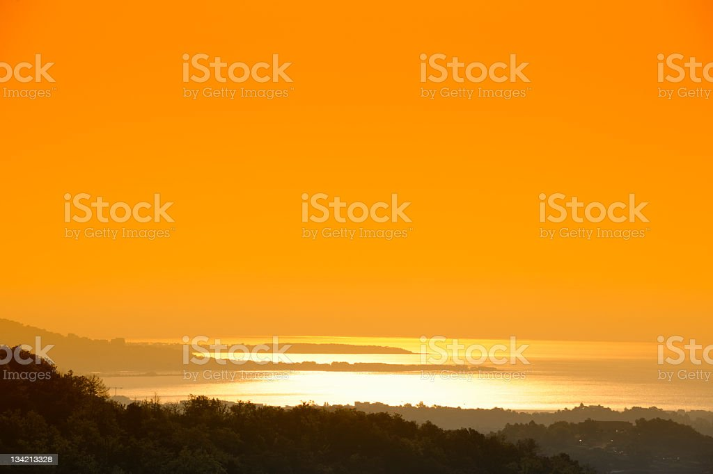 Telephoto Image of Sunrise over Cannes Bay royalty-free stock photo