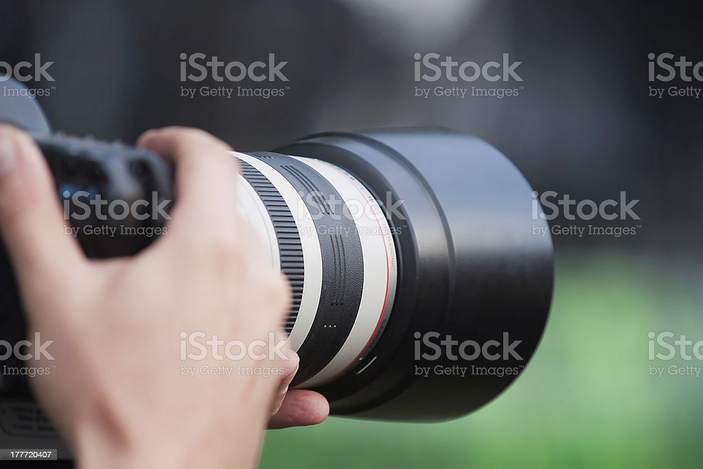 Telephoto lens shooting stock photo