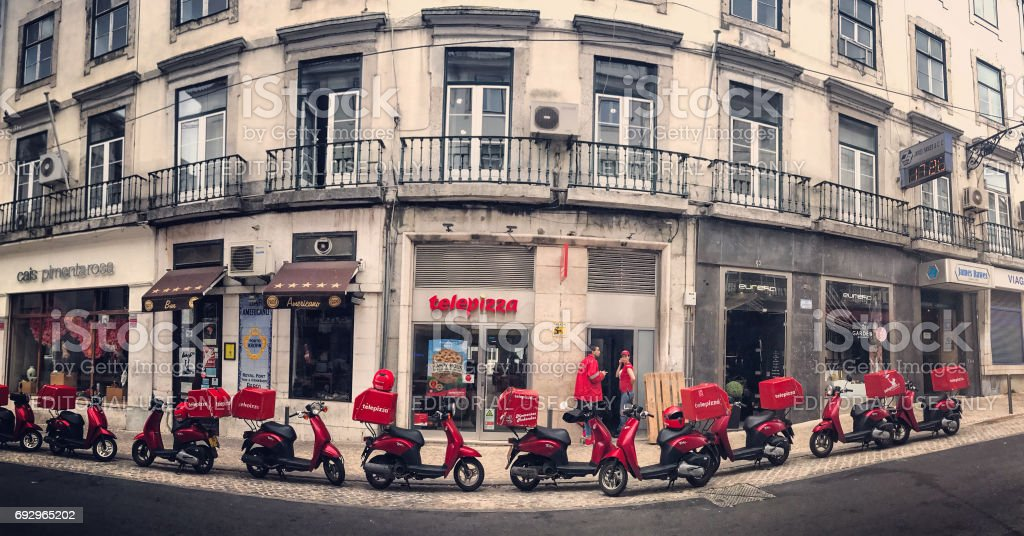 Telepizza delivery mopeds parked outside the cafe, Lisbon, Portugal. stock photo