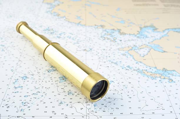 Telescope and  Nautical Chart. stock photo