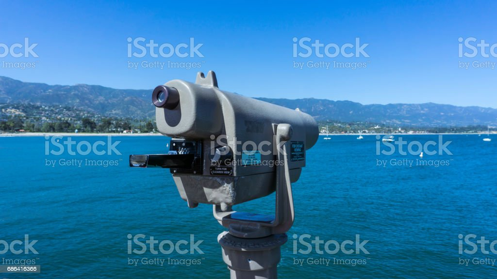 Telescope by the sea stock photo