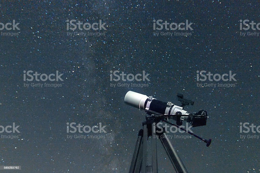 Telescope in real night sky. Refractor type. telescope stock photo