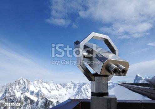 istock Telescope On Alps Snow Mountain Viewing Platform - XLarge 157675008
