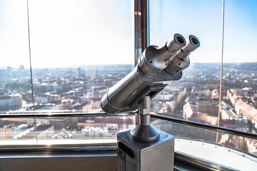 telescope on observation deck aimed at city center