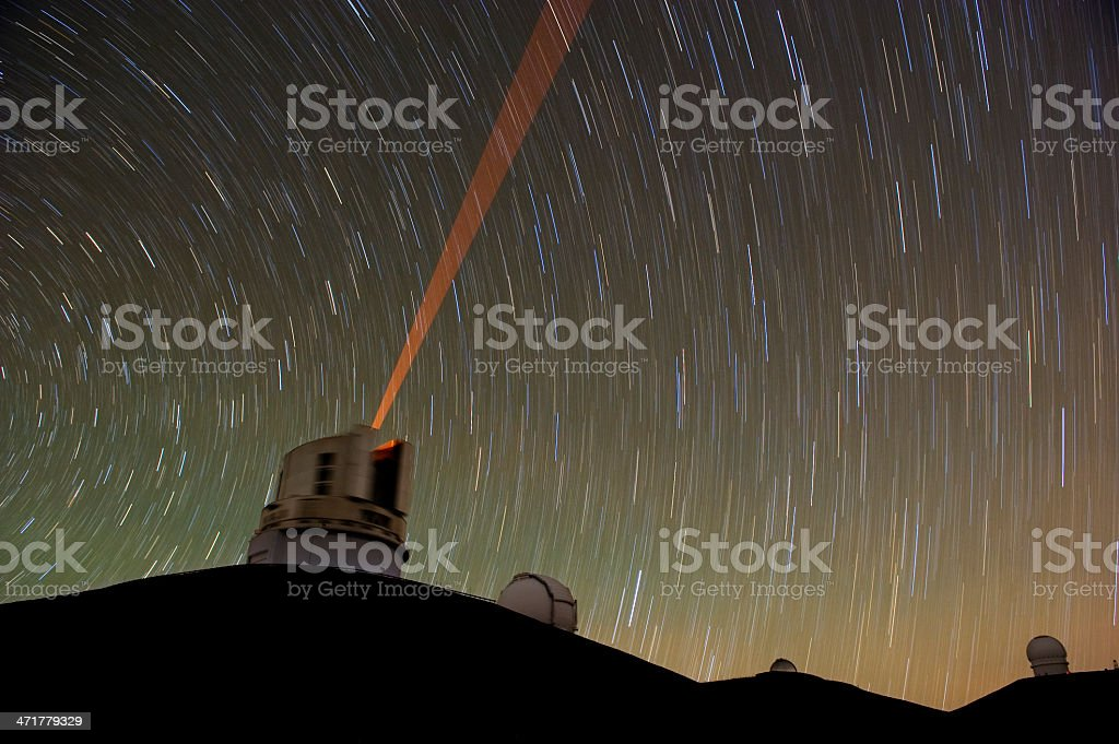 Telescope using a red laser guide star. royalty-free stock photo