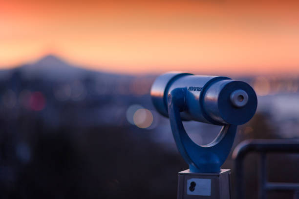 Telescope with View of Seattle Sunrise stock photo