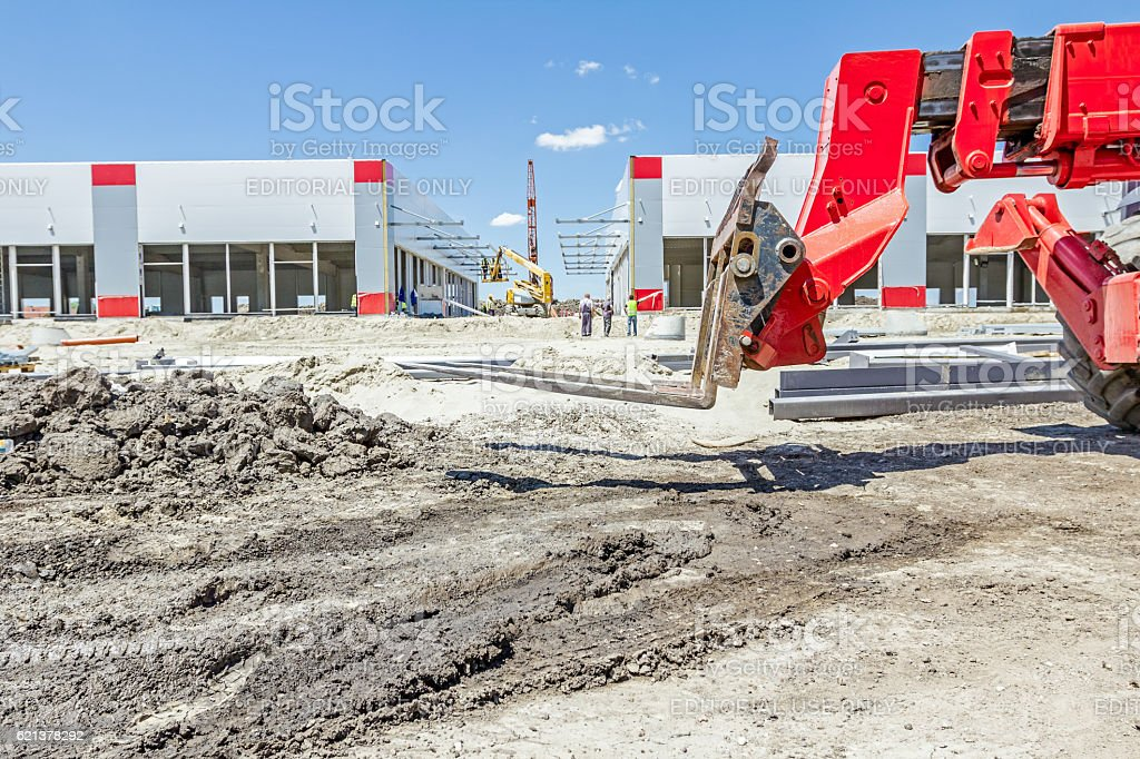 Telescopic forklift at the building site in background stock photo