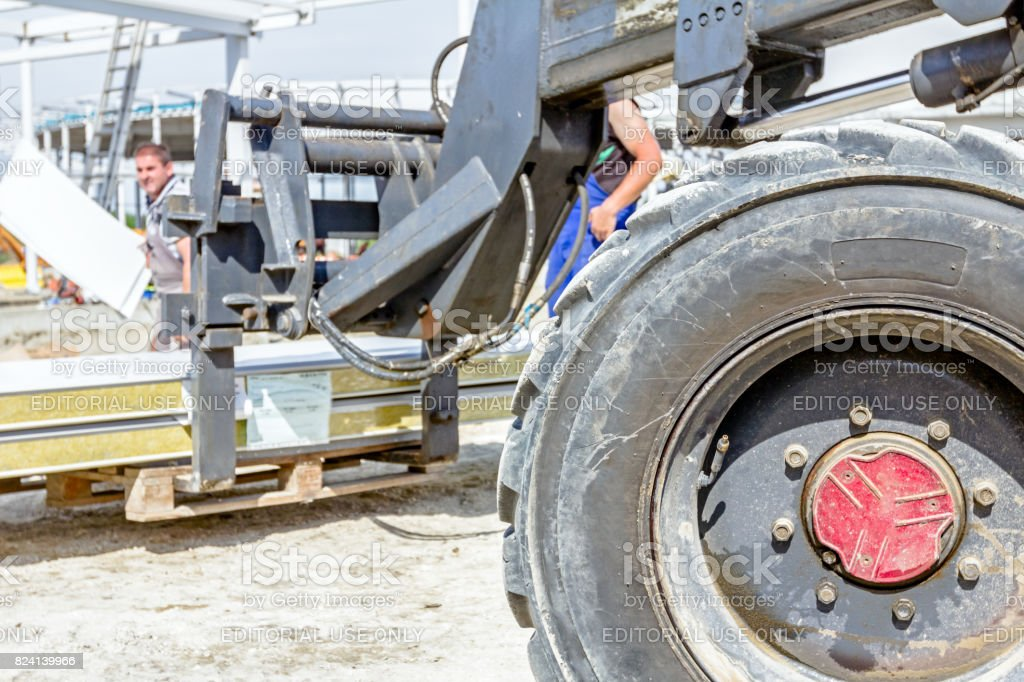 Telescopic forklift at the building site stock photo