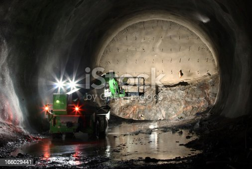 Telescopic handler on tunnel front, open and secured front.