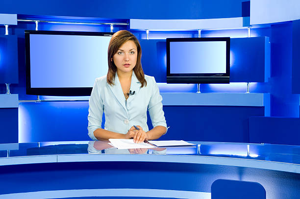 television anchorwoman at TV studio television anchorwoman at studio during live broadcasting anchor stock pictures, royalty-free photos & images