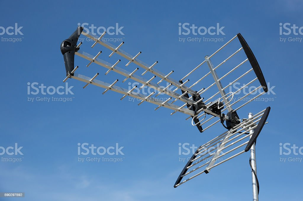 Television and communication aerial visible in a blue sky royaltyfri bildbanksbilder