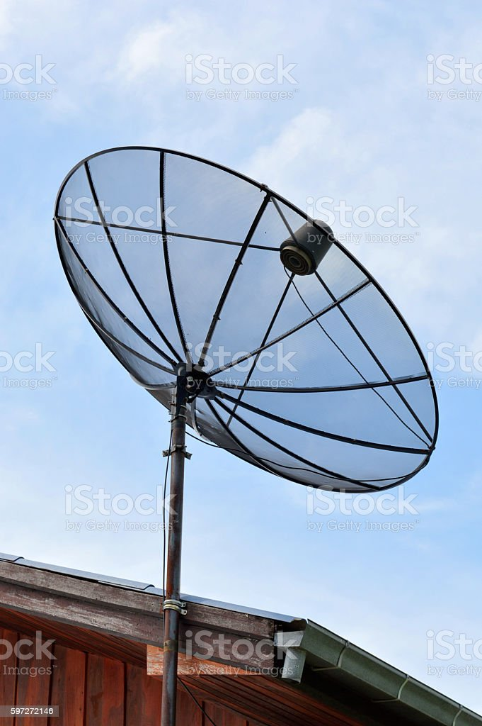 Television antenna against the afternoon sky royalty-free stock photo