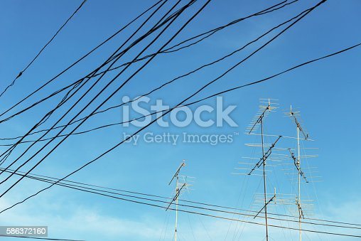 istock Television antenna on blue sky 586372160