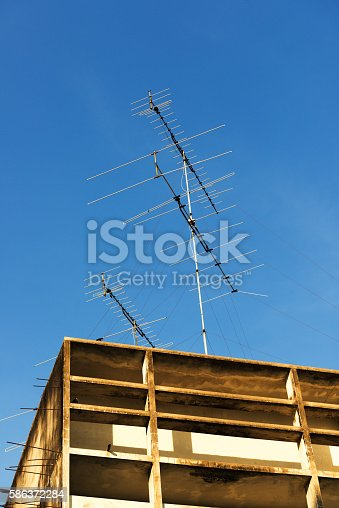 istock Television antenna on blue sky 586372284
