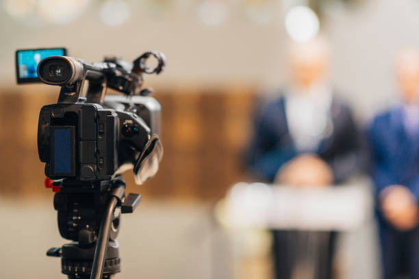 Television camera at a press conference Television camera at a press conference publicity event stock pictures, royalty-free photos & images