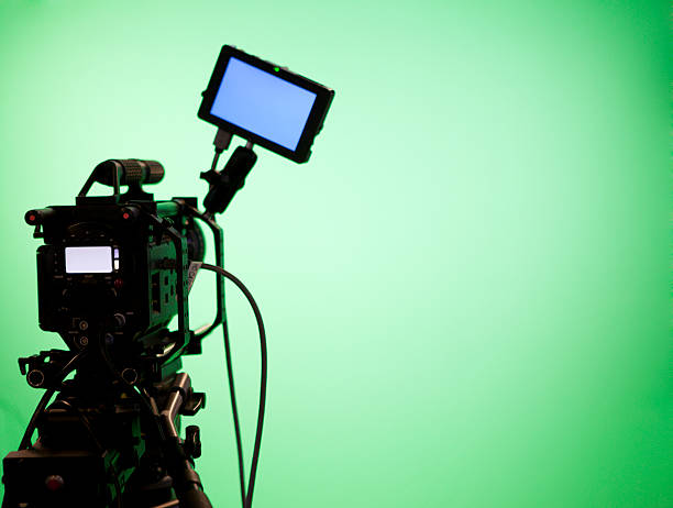 television camera on green screen background - green screen background stock photos and pictures