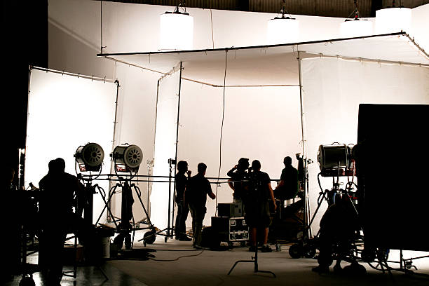 Television comercial production set. Silhouette of a production in progress on a white stage. studio stock pictures, royalty-free photos & images