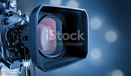 Close-up of a television camera lens on blurred background, bokeh