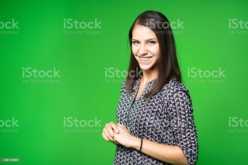 Television presenter recording in a green screen studio stock photo