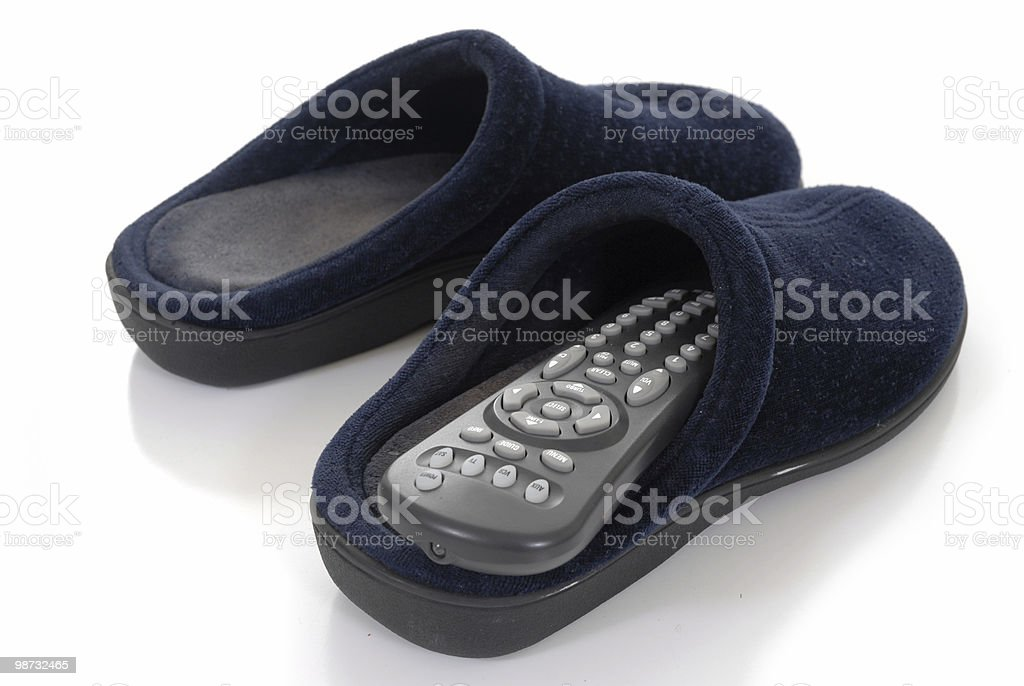 Television remote and couch potato shoes 免版稅 stock photo