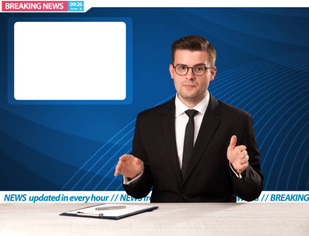 Television reporter telling breaking news at his studio desk with copy space Television reporter telling breaking news at his studio desk with copy space concept anchor stock pictures, royalty-free photos & images