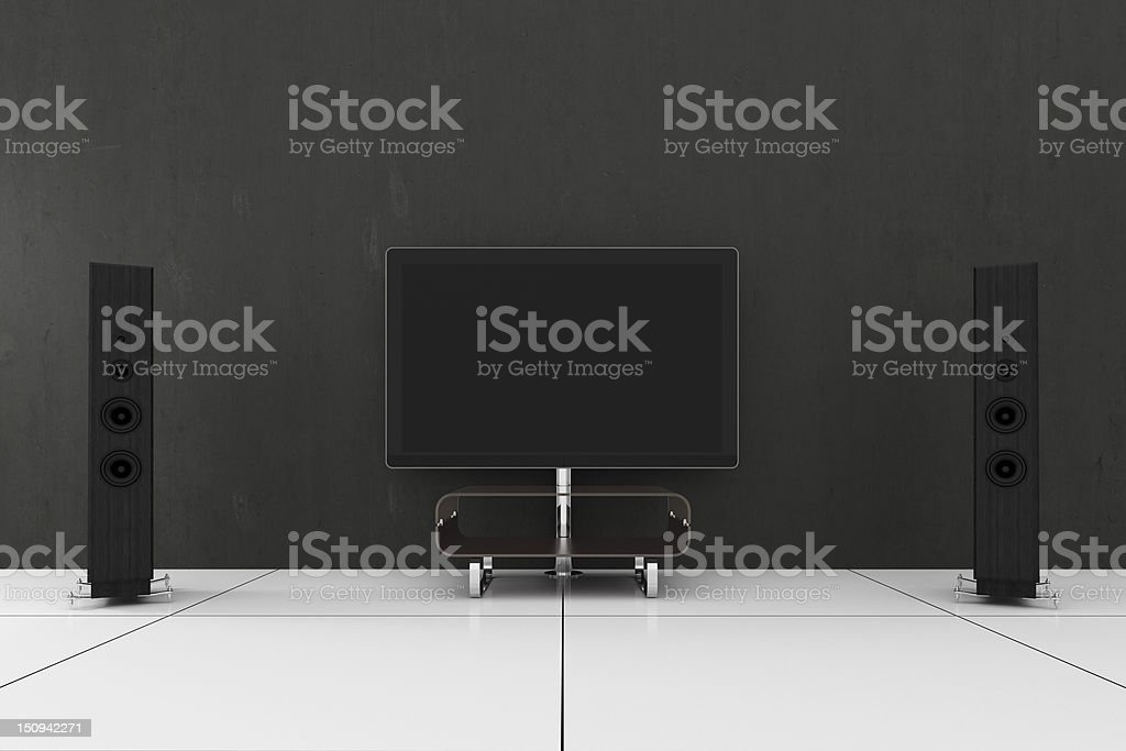 Television screen and speakers on white gloss tiled floor royalty-free stock photo