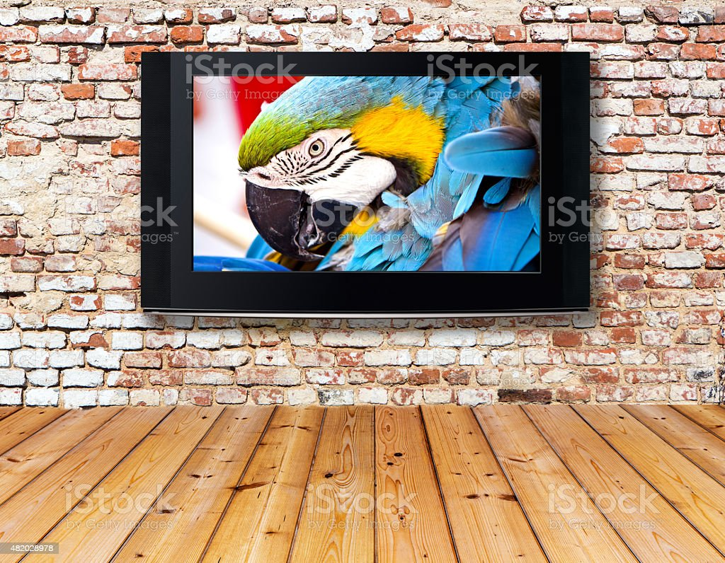 television set on an old wall stock photo